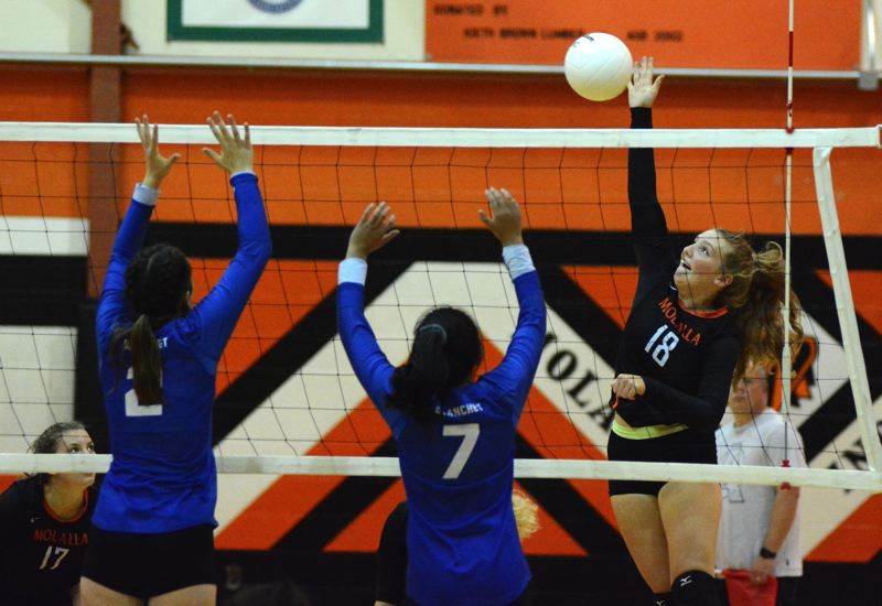PMG PHOTO: DEREK WILEY - Molalla junior Jackie Parker hits the ball over the net against Blanchet Catholic.