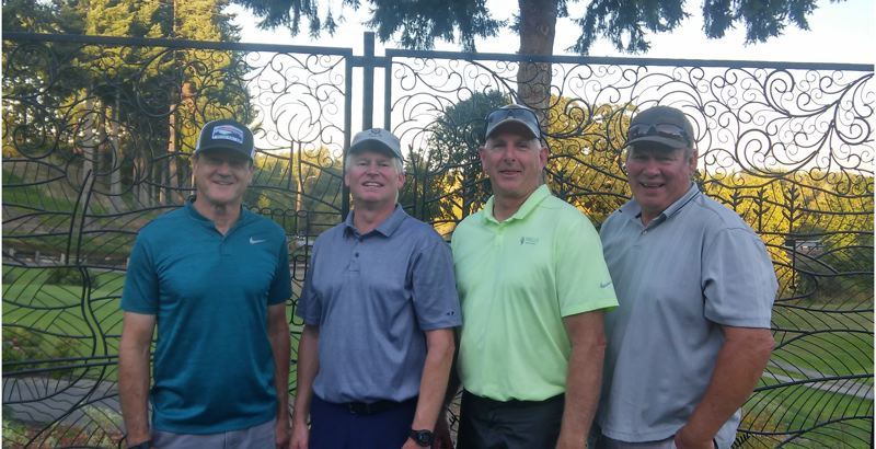 COURTESY PHOTO - Members of the Macadam Liquor team that won the St. Helens Mens Club championship at Wildwood Golf Course are (from left) Rick Waters, Mark Catlow, Tim Lohman and Steve Clark.