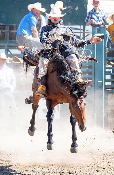 LON AUSTIN/CENTRAL OREGONIAN - Mason Stuller earns a score of 77 for his bareback ride Saturday at the Paulina Amateur Rodeo. Stuller won both the bareback and saddle bronc riding events to take the men's all-around title at the rodeo.