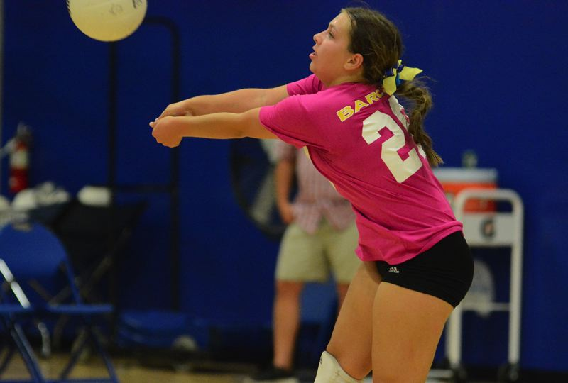 PMG PHOTO: DAVID BALL - Barlow libero Emma Corvese reaches out to bump a ball into the front row during the Bruins three-set loss to Sheldon on Thursday.