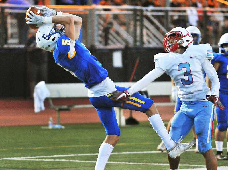 GRAPHIC PHOTO: GARY ALLEN - Wide receiver hauls in a pas in the first half of Newberg's win over South Salem on Friday evening.