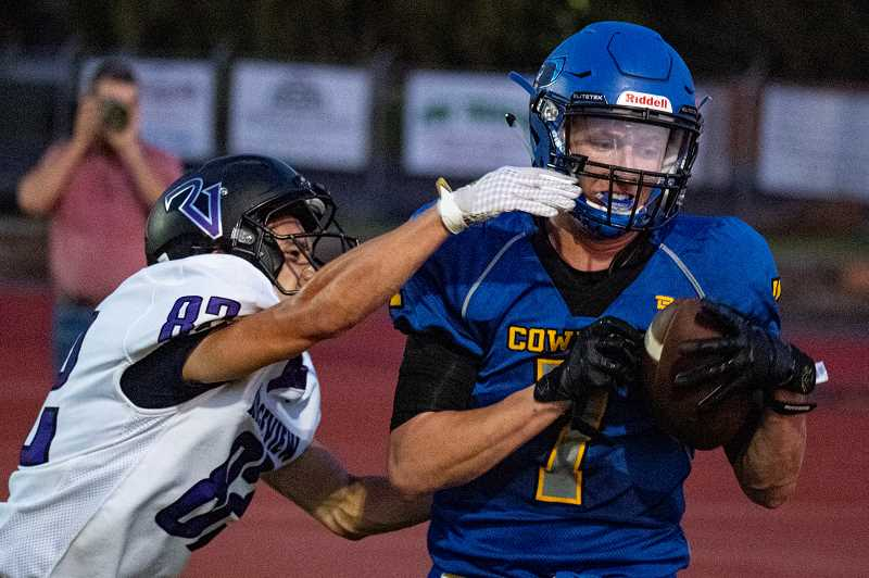 LON AUSTIN/CENTRAL OREGONIAN - Garett Bernard pulls in a touchdown pass from Brody Connell in the first half of the Cowboys 39-15 win over the Ridgeview Ravens. The pass was one of three touchdowns that Connell threw in the game.