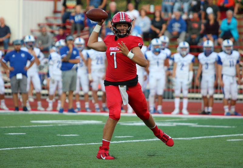 PMG PHOTO: JIM BESEDA - Oregon City quarterback Trey Martin threw four touchdown passes, including a 28-yard scoring strike to Calvin Green with 39 seconds to play in Friday's 41-39 home win over Grants Pass.