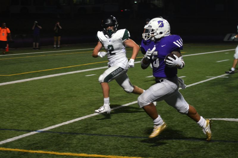 TIMES PHOTO: MATT SINGLEDECKER - Sunset senior Kylie Sagon makes his way to the end zone late in the second quarter against Tigard.