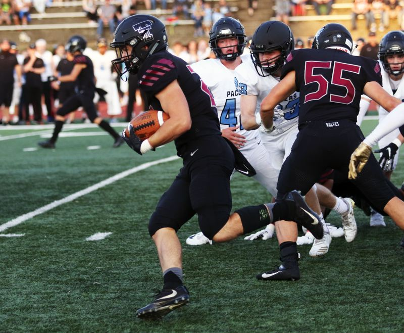 PMG PHOTO: DAN BROOD - Tualatin High School senior Kainoa Sayre breaks into the clear on his way to scoring on a 71-yard touchdown run early in Friday's game with Lakeridge.
