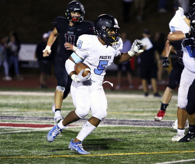 PMG PHOTO: DAN BROOD - Lakeridge High School senior Jalen John looks for room to run during Friday's game at Tualatin. John rushed for 103 yards on 17 carries in the contest.