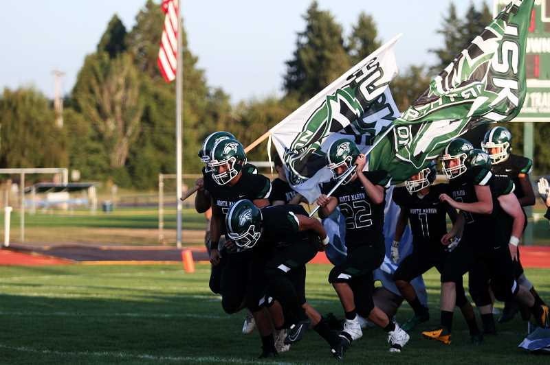 PMG PHOTO: PHIL HAWKINS - The North Marion Huskies rallied from a 27-18 deficit to defeat the visiting Stayton Eagles 37-27 in Friday night's season opener.