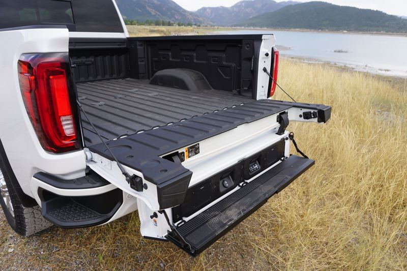 PMG PHOTO: JEFF ZURSCHMEIDE - GMC has adapted its six-way MultiPro tailgate to the new HD truck lineup. This innovative tailgate has a second, smaller tailgate within the main tailgate. You can fold it down to serve as a step up into the bed, or flip up a panel to extend the bed length.