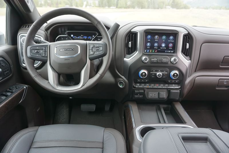 PMG PHOTO: JEFF ZURSCHMEIDE - The interior of the upper-level GMC Sierra line up rivals luxury cars for comfort and sophistication, with practically every automotive technology available.