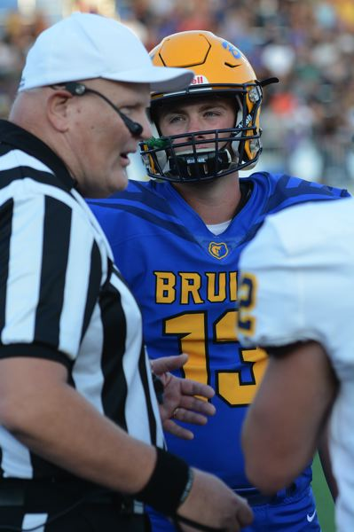 PMG PHOTO: DAVID BALL - Barlow QB Jaren Hunter listens to pre-game instructions during the captains meeting at midfield. He fired four touchdown passes in the first half.