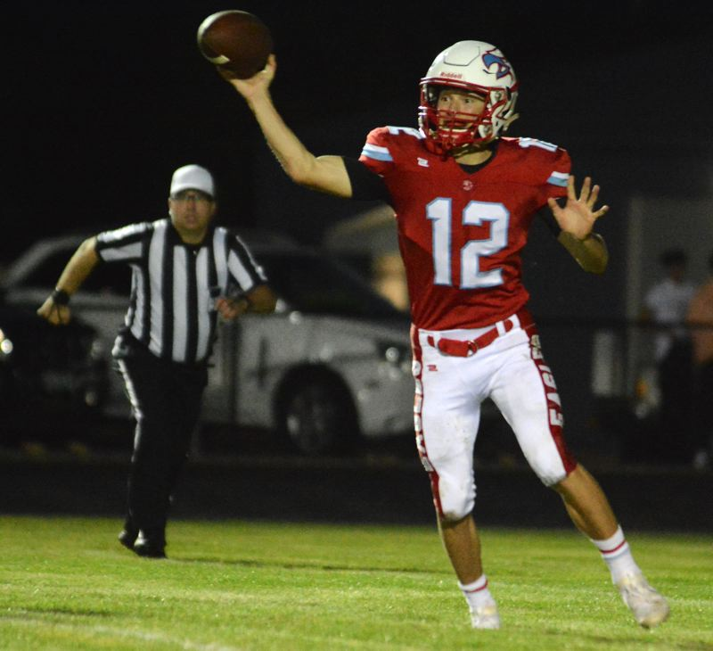 PMG PHOTO: DAVID BALL - Centennial QB Kyle Fitzgerald fires a pass toward the sideline during the Eagles 40-13 loss to South Medford on Friday.