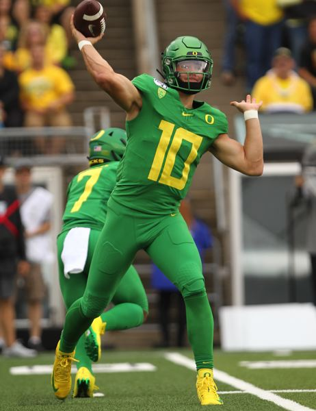 PMG PHOTO: JAIME VALDEZ - Justin Herbert passes for Oregon on Saturday against Nevada.