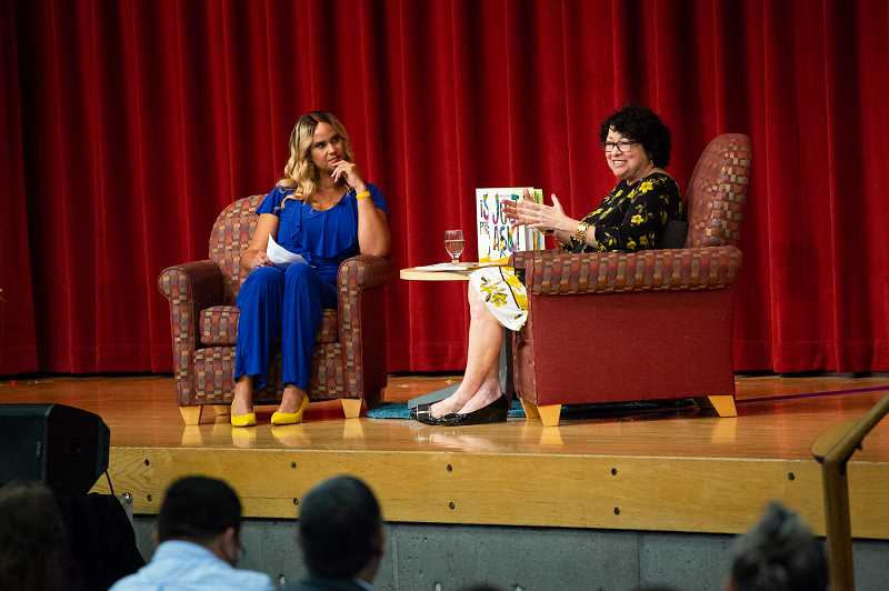 PMG PHOTO: ADAM WICKHAM - Television and radio host Tra'Renee Chambers (left) interviews U.S. Supreme Court Justice Sonia Sotomayor about her new book, 'Just Ask!' at the PCC Sylvania campus Saturday evening, Sept. 7.