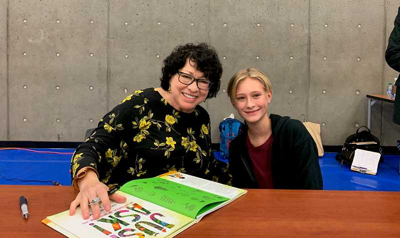 SUBMITTED PHOTO - Perry Cunningham, right, poses for a photo and book signing with U.S. Supreme Court Justice Sonia Sotomayor during a speaking engagement and book promotion event at Portland Community College.