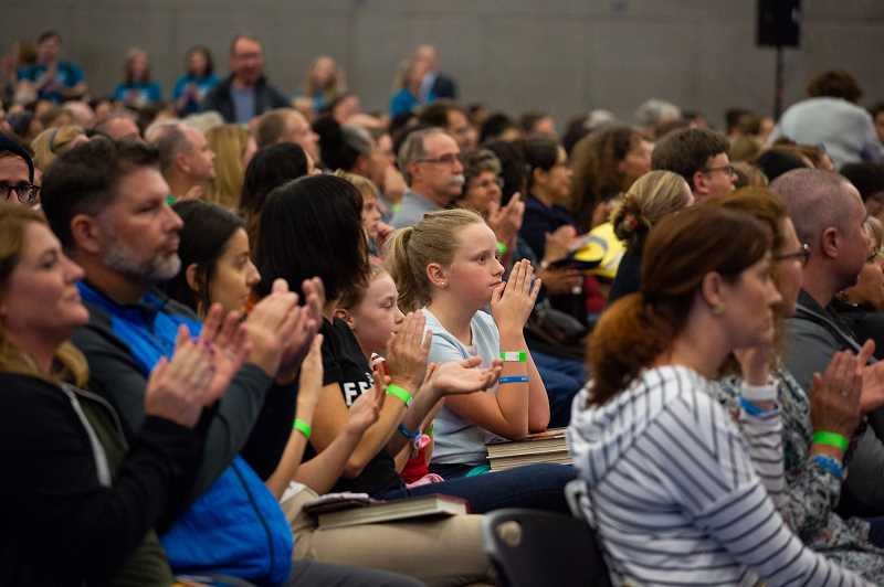 PMG PHOTO: ADAM WICKHAM - A packed house at Portland Community College applauds for U.S. Supreme Court Justice Sonia Sotomayor. Sotomayor visited Portland to discuss her latest book, which celebrates diversity and strength in children of varying abilities.