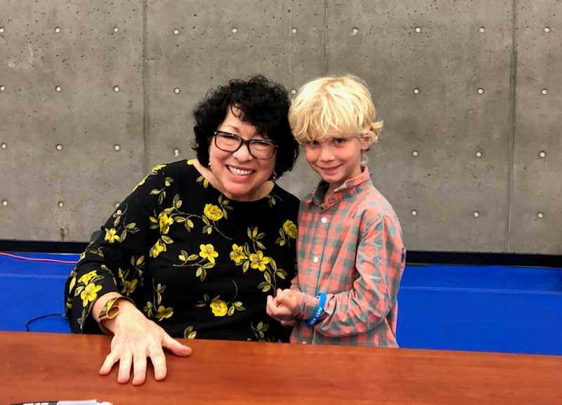 SUBMITTED PHOTO - Charlie Hoerster visits with Justice Sonia Sotomayor during a book signing Saturday, Sept. 7.