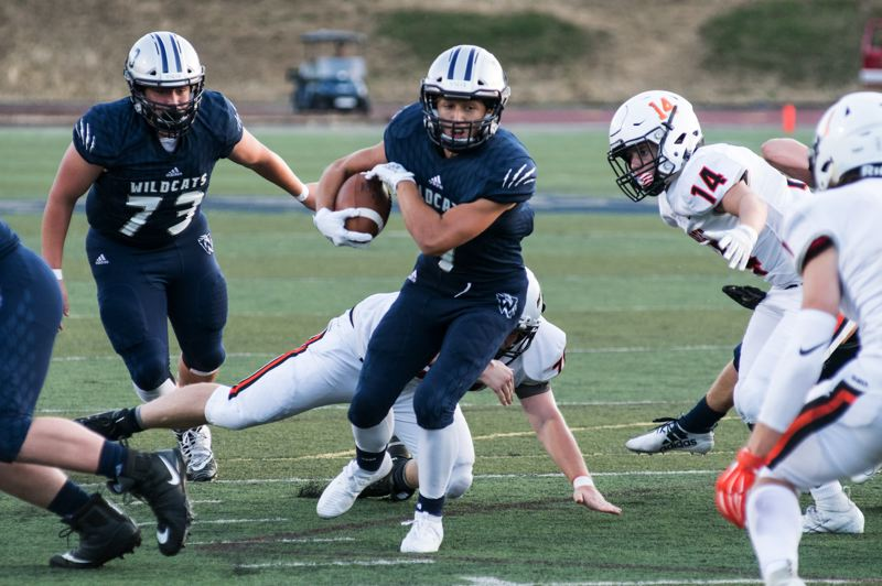 COURTESY PHOTO: GREG ARTMAN - Wilsonville junior Lucas Graves carries the ball against Crater Friday.