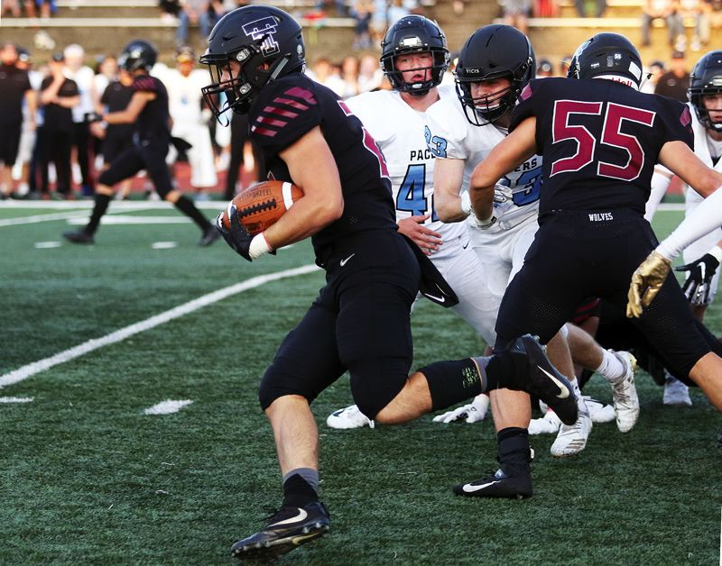 (Image is Clickable Link)    Tualatin High School senior Kainoa Sayre breaks into the clear on his way to scoring on a 71-yard touchdown run early in Friday's game with Lakeridge.