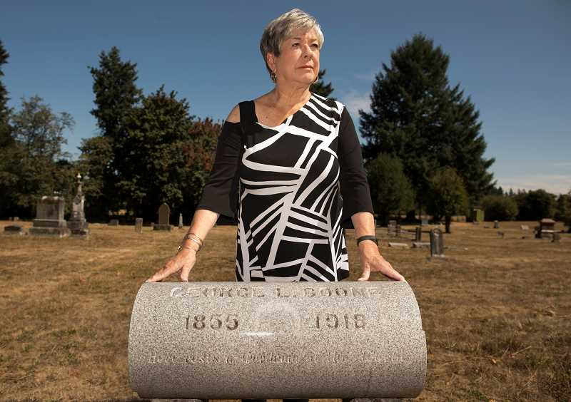 PMG PHOTO: JAIME VALDEZ - Janet Boone McGarrigle at the historic Butteville Cemetery, which holds the remains of her ancestor Jesse Boone, but no memorial stone.
