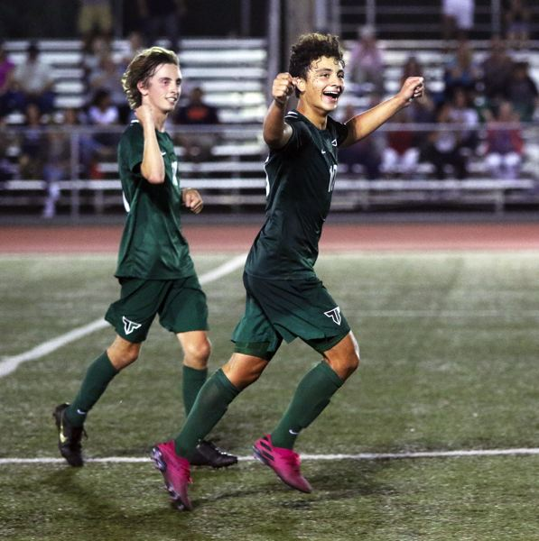 PMG PHOTO: DAN BROOD - Tigard High School seniors Jacob Theodoroff (left) and Marco Milan celebrate following the Tigers' 4-2 victory over Wilsonville.