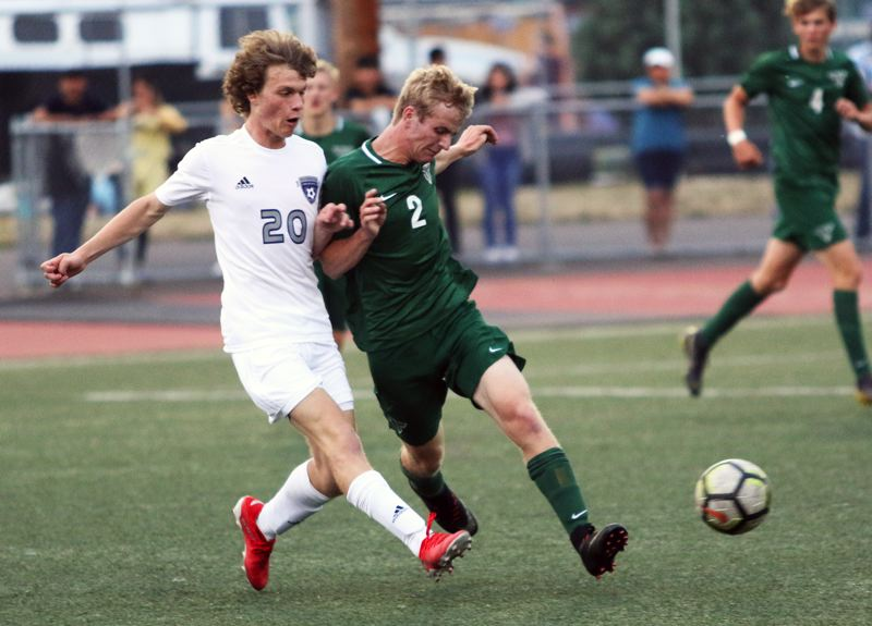 PMG PHOTO: DAN BROOD - Tigard High School junior Jack Hallam (2) battles Wilsonville's Elijah Powelson for the ball during the teams' non-league match.