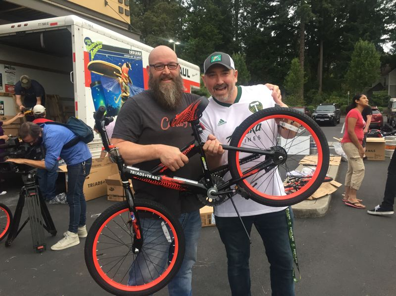 COURTESY PHOTO: CAN'D AID FOUNDATION - Volunteers assemble children's bicycles at Craft Pour House in Beaverton on Thursday, Sept. 5. The bikes were donated to students at Reedville Elementary School the next day.