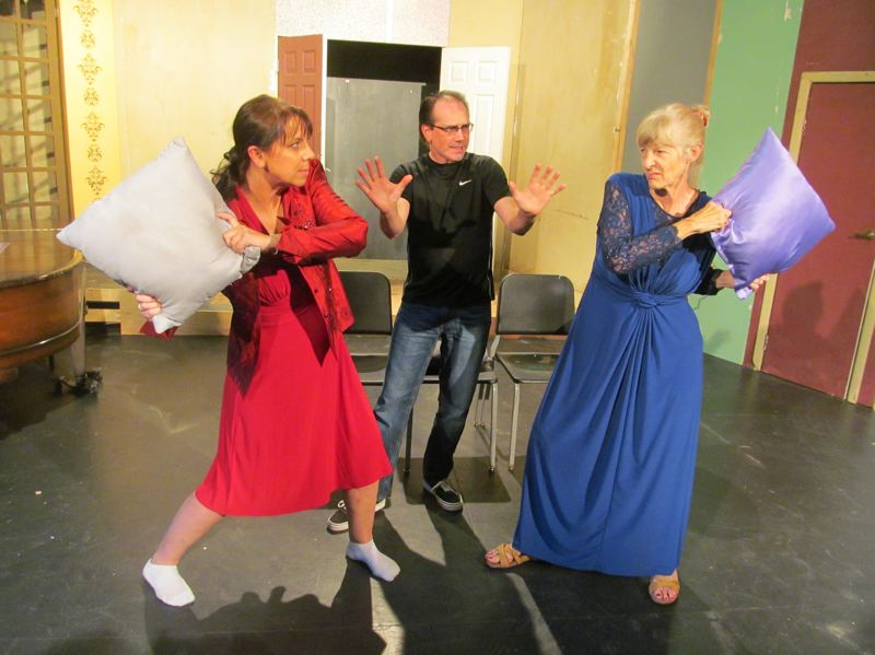 PHOTO BY ELLEN SPITALERI - Director Kraig Williams, center, tries to keep out of the way of warring divas Tracey Grant, left, and Kathleen Silloway.