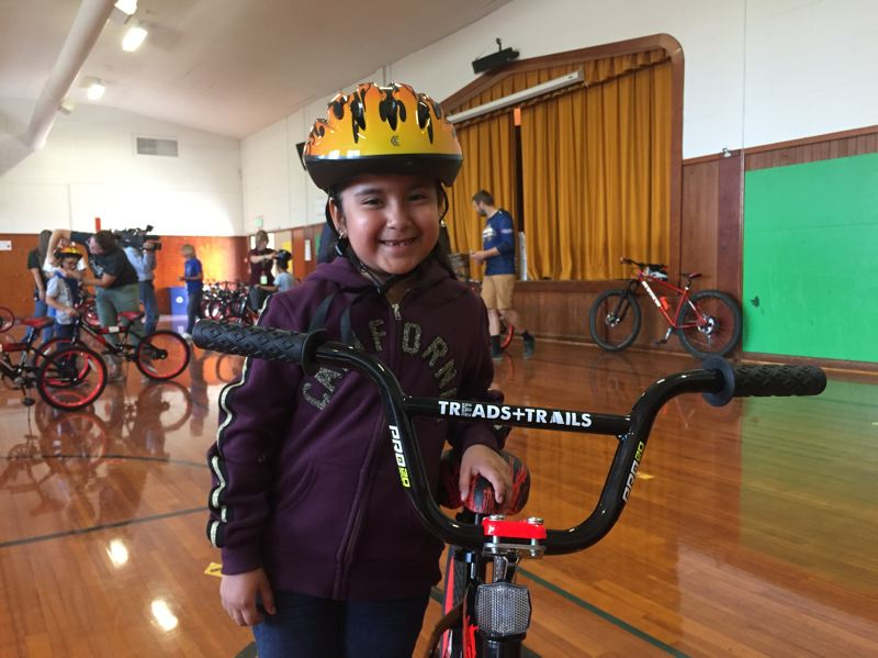 COURTESY PHOTO: CAN'D AID FOUNDATION - A Reedville Elementary School student poses for a photo with her new bicycle Friday, Sept. 6.