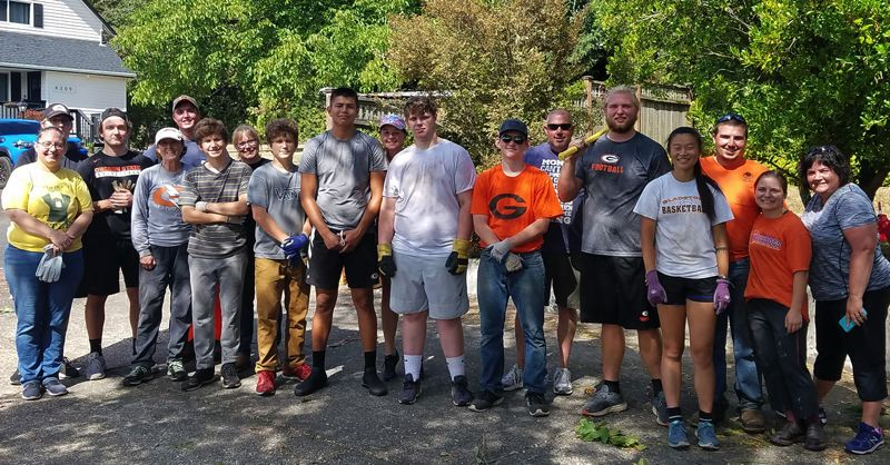 Students, recent graduates and staff from the Gladstone School District turned out in force to clean up debris after a sequoia damaged the home of retired Kraxberger Principal Nancy Bailey.