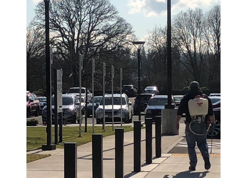 Michael Tulipat submitted this photo to state officials allegedly showing Clackamas Community College employees using pesticides in violation of Oregon laws.