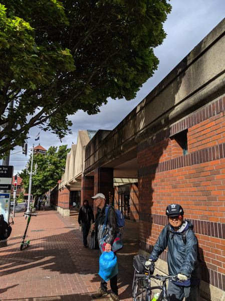 PAMPLIN MEDIA GROUP: JOSEPH GALLIVAN  - Portland's Greyhound bus station is now closed and up for sale as of Sept. 1. Ticketing and boarding have moved five blocks apart. MAX, TriMet bus and Greyhound patrons share the sidewalk with a variety of other travelers.