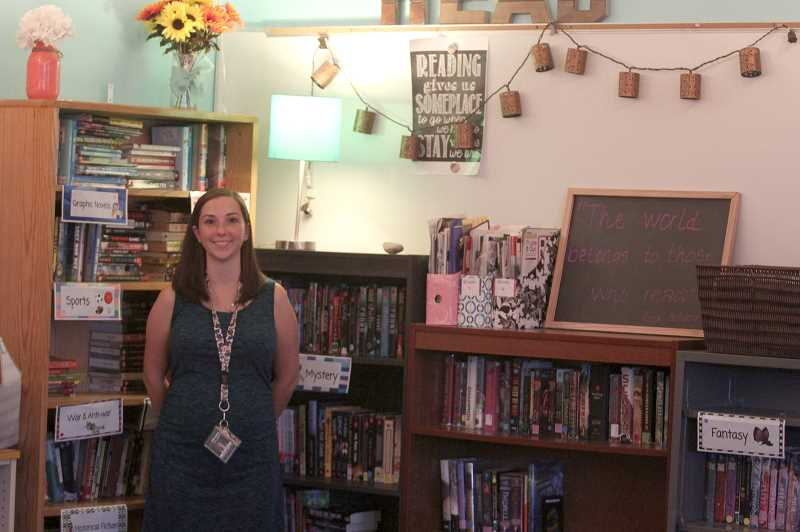 PMG PHOTO: PHIL HAWKINS - Eighth-grade humanities teacher Elyse Hansen spends her summers customizing her classroom to make it a friendly environment for her students.