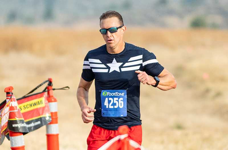 LON AUSTIN/CENTRAL OREGONIAN - Brandon Brasher crosses the finish line during the open race at the Intermountain Conference Preview. Brasher won the open race with a time of 17:31. The high school races were canceled because of air quality issues.