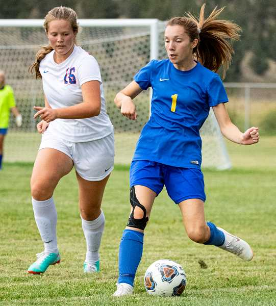 LON AUSTIN/CENTRAL OREGONIAN - Jacey Allen plays the ball away from a Madras defender during the Cowgirls' 3-0 loss to the White Buffalos on Thursday. Crook County is back in action on Saturday when they go on the road to take on the La Pine Hawks in a 3 p.m. match.