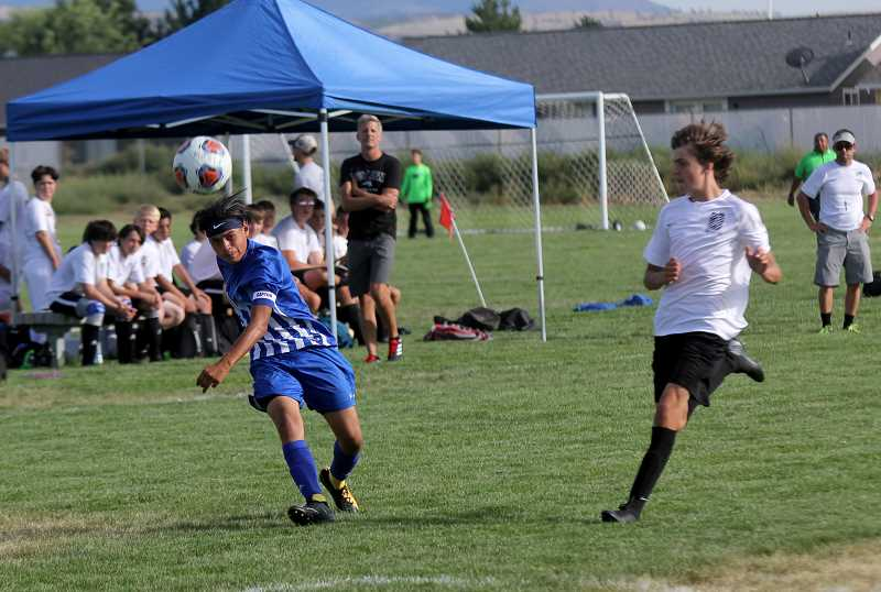 STEELE HAUGEN - Franklin Pineda scores two goals during Madras' 8-1 home victory over Sisters Sept. 3.
