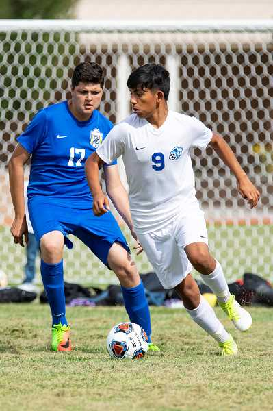 LON AUSTIN - Manny Flores dribbles to ball past a Crook County player. The Buffs' won 6-2 over the Cowboys Sept. 5.