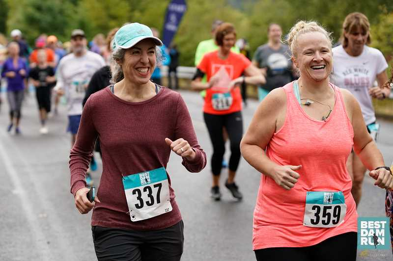 COURTESY PHOTO: OREGON ROAD RUNNERS CLUB - Athletes in last year's Best Dam Run are all smiles as they journey along the course.
