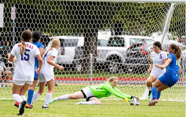 LON AUSTIN - Madras goalie Katie Weygandt dives for a save during the Lady Buffalos' 3-0 win over 5A Crook County Sept. 5.