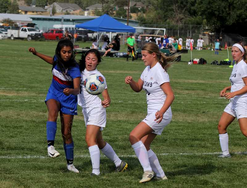 STEELE HAUGEN - Naomi DeAnda kicks the ball past a Sisters player. The Lady Buffs lost 2-1 to the Outlaws Sept. 3, and beat Crook County 3-0 Sept. 5.