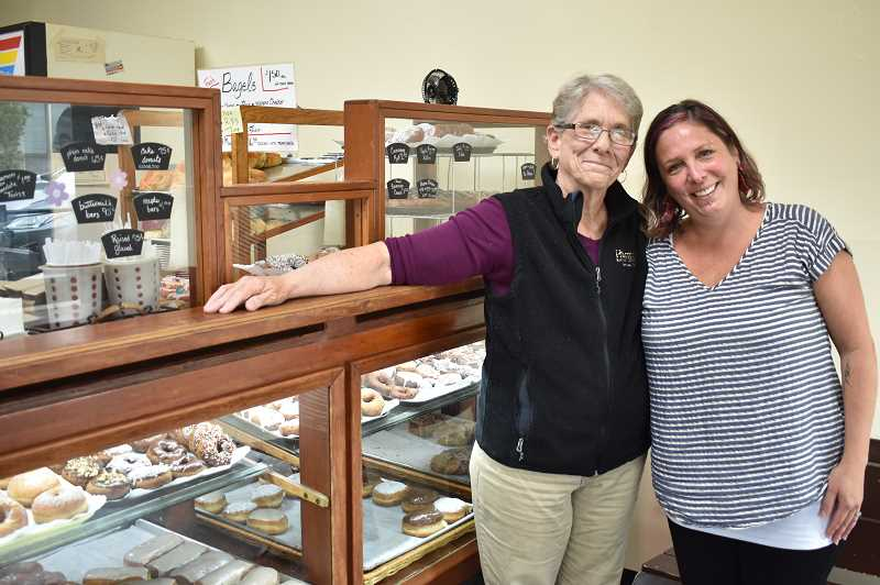 PMG PHOTO: EMILY LINDSTRAND - Linda Lawrence and her niece Jenny Beaudoin smile inside of Harmony Baking Company. When Lawrence and chef Sandy Walker retire in December, Beaudoin and her husband will take the reigns at the bakery.
