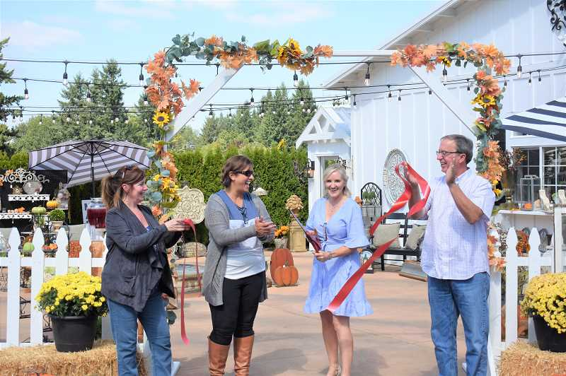 PMG PHOTO: EMILY LINDSTRAND - Leaders from the Estacada Chamber of Commerce clap after Peacock Ridge Farm owner Renae Frey cuts the ribbon during a ceremony on Friday, Sept. 6.