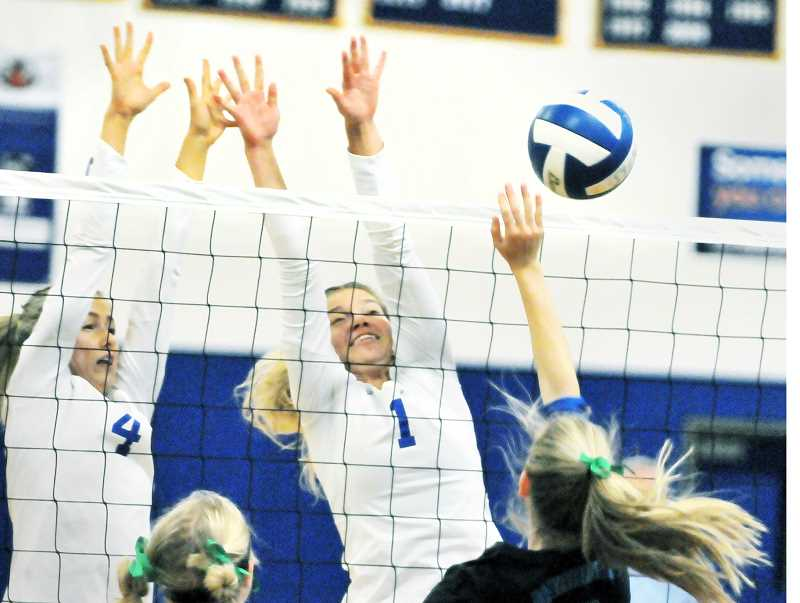 GRAPHIC PHOTO: GARY ALLEN - Despite a shorter roster than most, Newberg volleyball has been successful defending around the net this season.