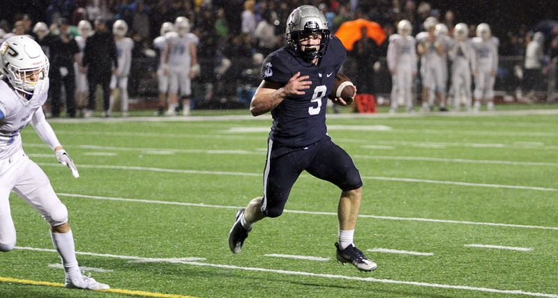 PMG PHOTO: MILES VANCE - Lake Oswego senior Casey Filkins (shown here in 2018) ran for 210 yards and three touchdowns during the Lakers' 42-21 Friday win over West Salem.