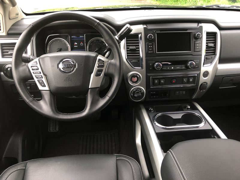 PMG PHOTO: JEFF ZURSCHMEIDE - The 2019 Nissan Titan can be ordered with a heated steering wheel, a 360-degree around-view monitor, and a 7-inch touchscreen infotainment system with navigation, satellite radio, Android Auto and Apple CarPlay, and even voice recognition.