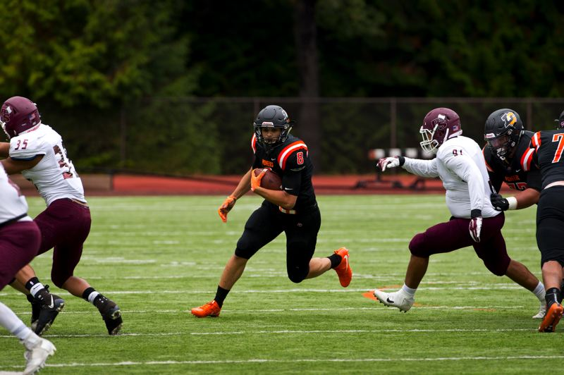 COURTESY PHOTO: LEWIS & CLARK COLLEGE - Michael Abraham, a running back from Central Catholic High, returns as a key weapon for the Lewis & Clark Pioneers.