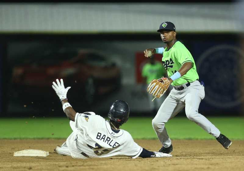 COURTESY PHOTO: CRAIG MITCHELLDYER - Hillsboro's Liover Peguero turns a double play during the Hops Game 4 loss to Tri-City in the NWL Championship Series Tuesday, Sept. 10, at Gesa Stadium in Pasco, WA.
