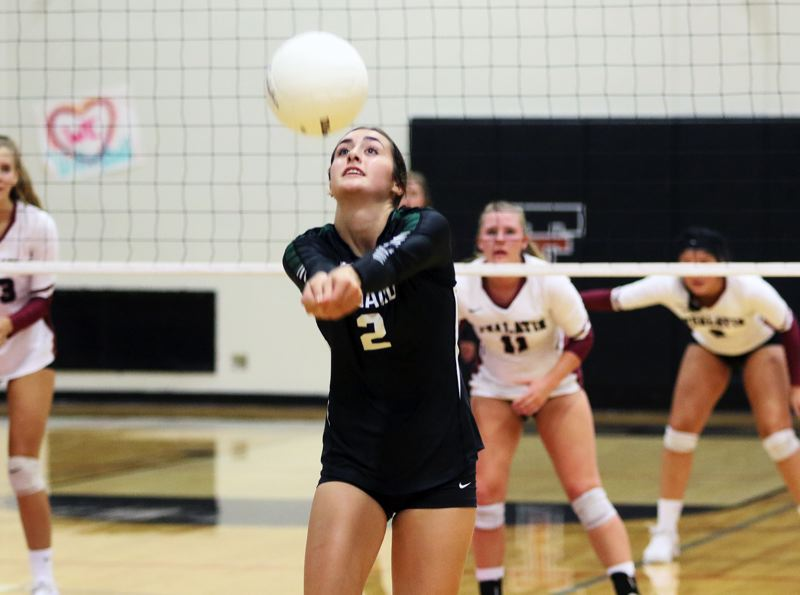 PMG PHOTO: DAN BROOD - Tigard High School junior setter Kennedy Peery keeps the ball in play during the first set of the Tigers' match at Tualatin on Tuesday.