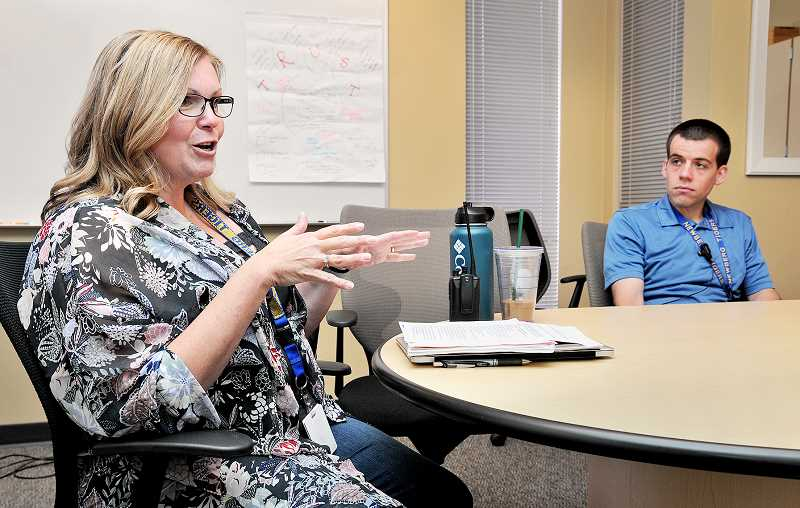 GRAPHIC PHOTO: GARY ALLEN - Graphic photo: Gary AllenNHS principal Tami Erion (left) and vice principal Mark Brown discuss the culture of learning and care the school is attempting to develop as fall classes begin.