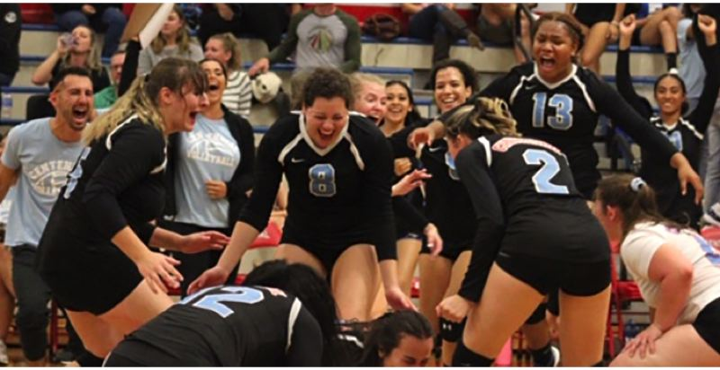 CONTRIBUTED PHOTO: CHRISTIAN ROBERTS - Centennial players celebrate after converting match point in Mondays four-set home win over Gresham.