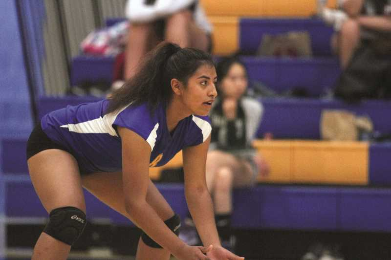 PMG PHOTO: PHIL HAWKINS - Ashley Marin and the Gervais volleyball team took the Delphian Dragons to extra points in a 27-25 opening set on Tuesday at Gervais High School and went on to fall 3-0 (27-25, 25-13, 25-14) in the Cougars' home opener.